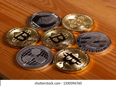 Cryptocurrency coins on wooden background