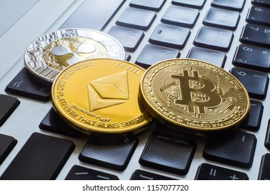 cryptocurrency coins - Ripple, Bitcoin, Ethereum