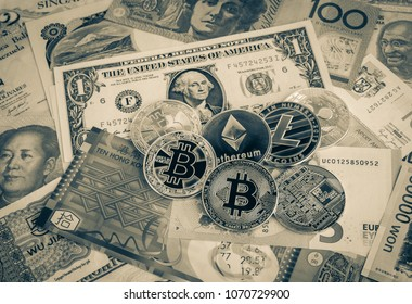 Cryptocurrency coins set, bitcoins,ethereum, litecoin, ripple on international world banknotes. Concept of electronic money, digital currency for exchange, transfer digital asset through blockchain.