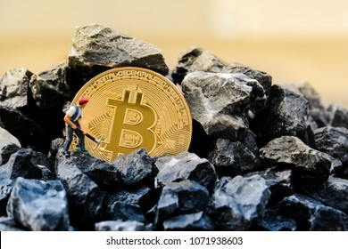 Cryptocurrency concept with miners and coins working in bitcoin mine
