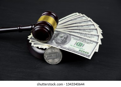 Cryptocurrency Dash coin with gavel on a Dollar bills