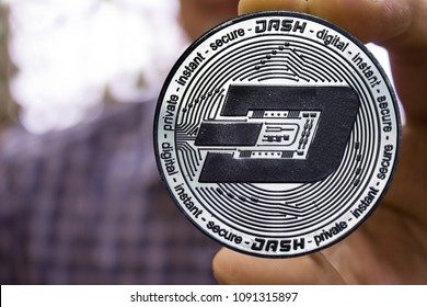 Cryptocurrency Dash  in the man's hand.
