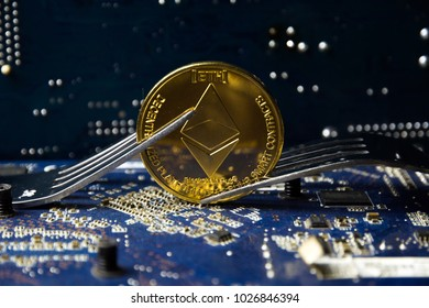 Cryptocurrency Ethereum (ETH) with a fork on the motherboard