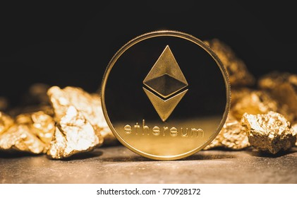 cryptocurrency Ethereum and a mound of gold nuggets - Business concept image