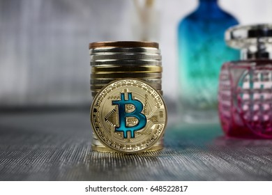 Cryptocurrency gold bitcoin coin with a blue sign