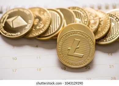 Cryptocurrency golden Bitcoin,Litecoin ,Ethereum coin  on calendar, digital currency concept