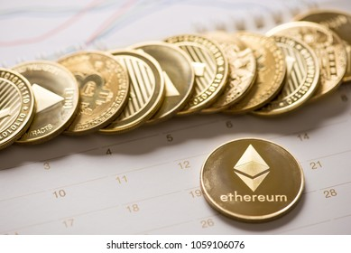 Cryptocurrency golden Bitcoin,Litecoin ,Ethereum coin on calendar, selective focus on Ethereum , digital currency concept