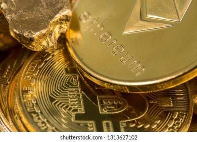 cryptocurrency golden coins - Bitcoin, Ethereum, Litecoin on the background of gold nuggets. Virtual money concept.