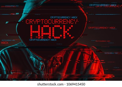 Cryptocurrency hack concept with faceless hooded male person, low key red and blue lit image and digital glitch effect