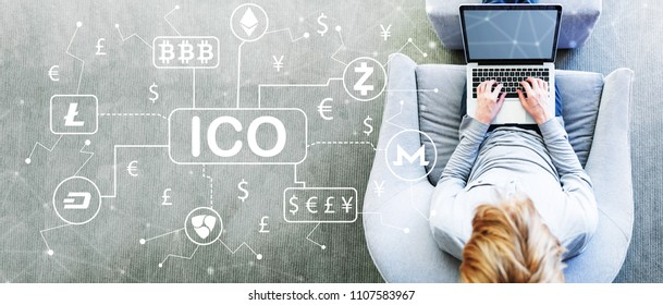 Cryptocurrency ICO theme with man using a laptop in a modern gray chair