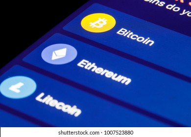 Cryptocurrency market. Bitcoin, Ethereum, Litecoin, Ripple. A cryptocurrency is a digital or virtual currency that uses cryptography for security. Crypto currency  macro view on smartphone