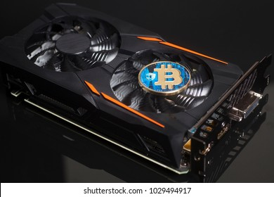 Cryptocurrency mining concept with bitcoin on a videocard