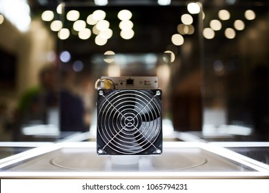 Cryptocurrency mining equipment - ASIC - application specific integrated circuit on farm stand at expo