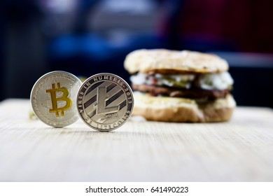 Cryptocurrency physical litecoin and bitcoin and burger