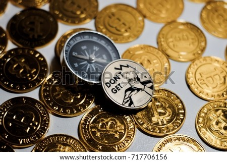 Cryptocurrency Physical Metal Bitcoin Coin On The Gold Bitcoins Near Black Compass Money Concept