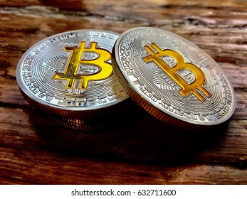 Cryptocurrency physical two silver bitcoin coins on the wooden table