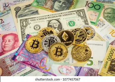 Cryptocurrency set, bitcoins, ethereum, litecoin, ripple on cash worldwide banknotes. Electronic money concept, fund investment, foreign currency exchange, transfer digital asset through blockchain.