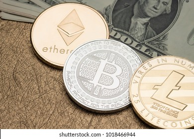 cryptocurrency Silver and gold Bitcoin,litecoin,ethereum on dollar banknote on golden table,Virtual Digital money on blockchain concept.financial business.crypto currency mining