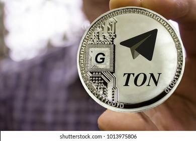 Cryptocurrency TON from telegram in the man's hand. gram