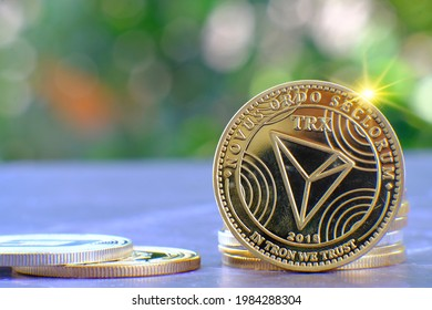 Cryptocurrency Tron (TRX) coin on table and digital currency money concept