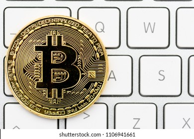 cryptocurrency, virtual currency  bitcoin, on keyboard