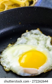 Cryspy egg on small frying pan.