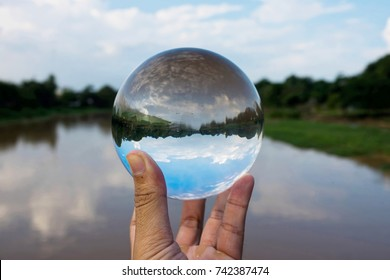 Crystal ball display a clear water and dirty water,enviroment saving, abstract meaning environment in your hand.