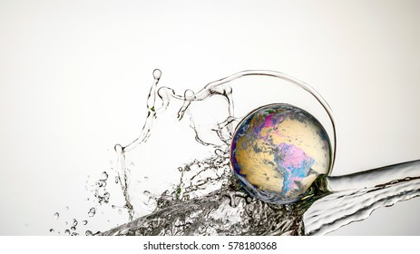 Crystal Ball Earth Splash - Water cascading on and over an Earth embossed Crystal Ball