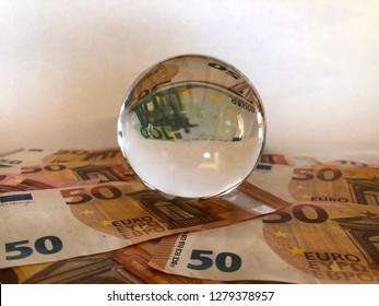 Crystal ball and euro banknotes. Creative concept, Predicting the European economic forecast