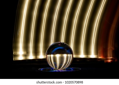 Crystal ball influenced by an artistic colorful light play background