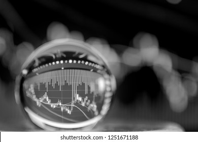 Crystal ball on the background of Stock Market Chart exchange trading (black and white)