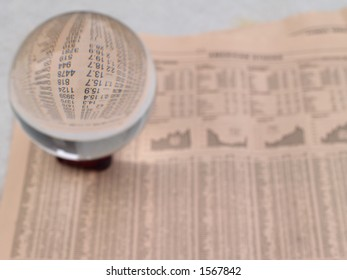 Crystal Ball on the financial section of a newspaper
