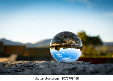 crystal ball and reflection of rural landscape
