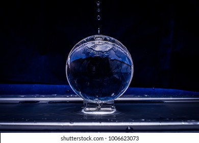 CRYSTAL BALL SPLASHED WITH WATER