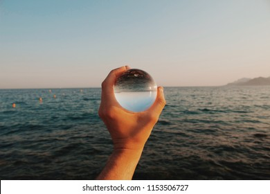 Crystal ball where the sun reflects with the sea