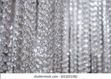 Crystal Beads Blind Curtain Background concept of Luxury Glittering Beaded Backdrop for Wedding Celebration or Wedding Ceremony Invitation. Sparkling Diamond-like Stone Pattern for Design or Copyspace