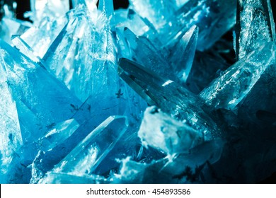 crystal blue ice in black background