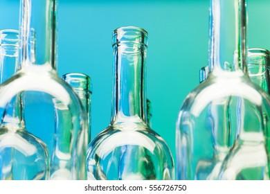Crystal bottlenecks of empty glass wine bottles