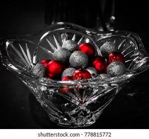 Crystal bowl filled with silver and red Christmas balls in black and white