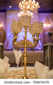 Crystal candle holder as a center piece at a wedding reception.