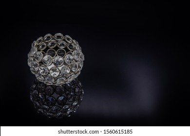 A crystal candle holder in a reflexion composition