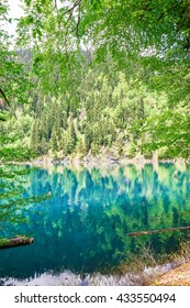 The crystal clear blue lake in the mountains