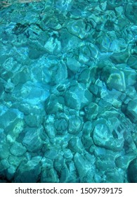 Crystal clear blue sea water. Transparent surface. Nature background.
