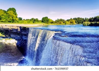 Crystal clear blue waters of Jagala waterfall. Jägala Juga, Estonia.