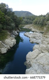 Crystal clear and deep blue river in the area of Nelson, New Zealand