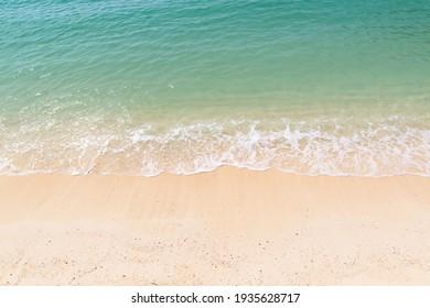 Crystal clear emerald green sea with white sandy beach, Ao Ton Sai Bay, Koh Phi Phi Don, Krabi, Thailand.