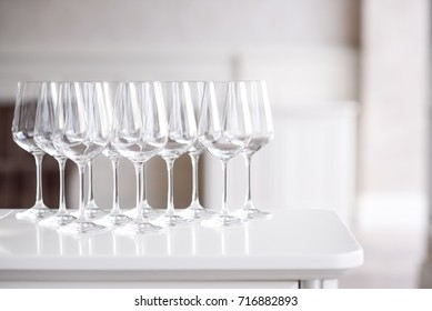 Crystal clear empty wine glasses on the table. Alcohol background. A lot of wine glasses at the bar.