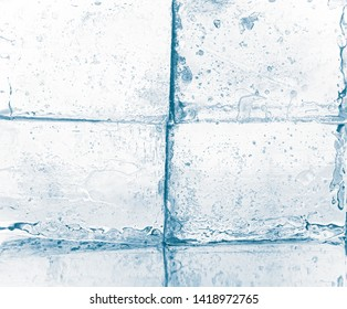 Crystal clear frosty ice cubes against white background.