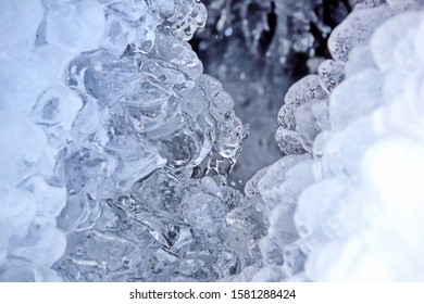 crystal clear ice over a mountain stream