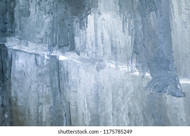 Crystal clear icicles hanging down in frozen cave, Jagala Waterfall, Estonia. Beautiful winter
